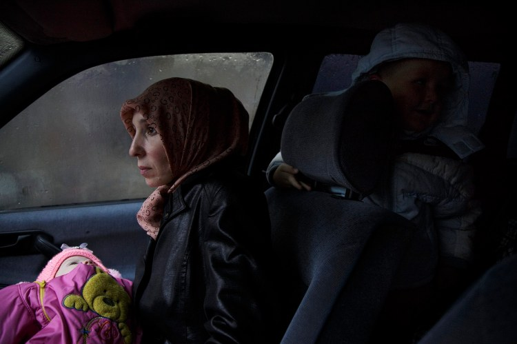 Alime Abdullaeva with her children sits in the car right after the court decision to hold her husband Teymur Abdullaev in pretrial detention facility  for two month. Her husband was arrested on October 12th for alleged involvement with Hizbut Tahrir, which declared terrorist organization in Russian Federation.