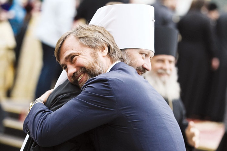 Vadim Novinsky (R) hugs archbishop Pavel, the abbot of the Kyiv Pechersk Lavra Orthodox monastery, celebrating the arrival to the monastery of the relics of St. Panteleimon from the mount of Athos in Greece on Oct. 20, 2012. (UNIAN)
